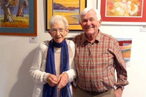 Riverland U3A members Sarah Summersett and Brian Dalzell in front of works created by Sarah.